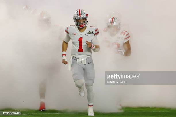 Justin Fields of the Ohio State Buckeyes takes the field for the College Football Playoff National Championship game against the Alabama Crimson Tide...