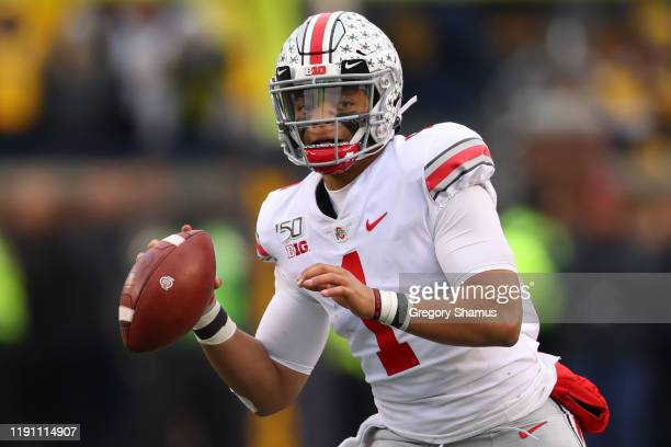 Justin Fields of the Ohio State Buckeyes throws a second half touchdown against the Michigan Wolverines at Michigan Stadium on November 30 2019 in...