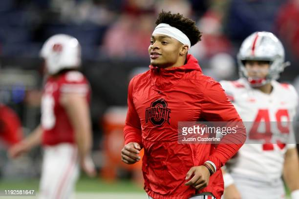 Justin Fields of the Ohio State Buckeyes warms up before the Big Ten Championship game against the Wisconsin Badgers at Lucas Oil Stadium on December...