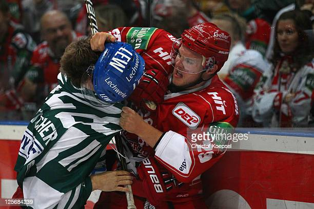 Justin Fletcher of Augsburger Panther boxes against Brett Breitkreuz of Koelner Haie during the DEL match between Koelner Haie and Augsburger Panther...