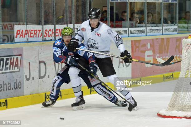 Justin Florek of Iserlohn and Oliver Mebus of Nuernberg battle for the ball during the DEL match between Iserlohn Roosters and Thomas Sabo Ice Tigers...