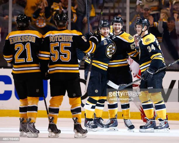 Justin Florek of the Boston Bruins celebrates his goal with teammates Carl Soderberg and Andrej Meszaros in the first period against the Detroit Red...