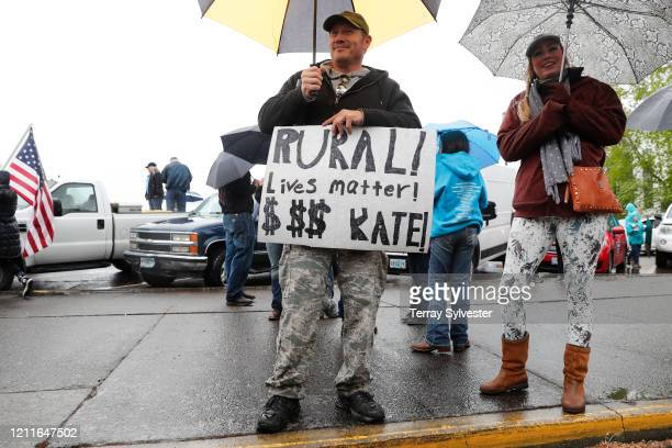 Justin Ford of Grants Pass holds a sign saying Rural lives matter Kate at the ReOpen Oregon Rally on May 2 2020 in Salem Oregon Demonstrators...