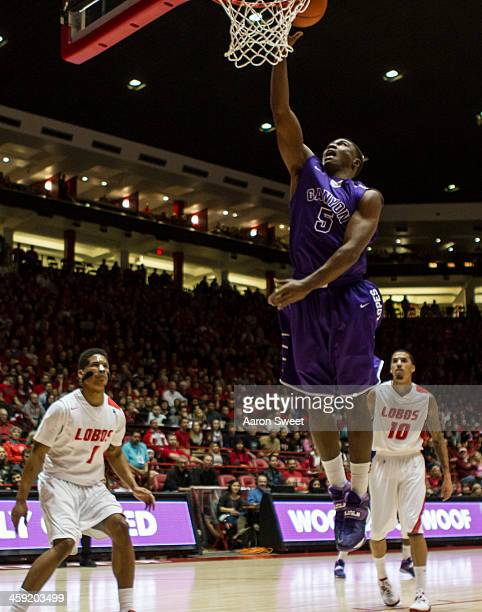 Justin Foreman of the Grand Canyon Antelopes makes two as Cleveland Thomas and Kendall Williams of the New Mexico Lobos look on during the Monday...