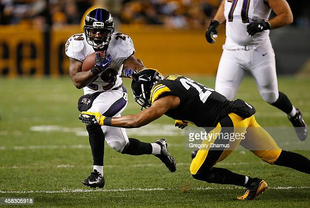 Justin Forsett of the Baltimore Ravens avoids a tackle by Brice McCain of the Pittsburgh Steelers during the first quarter at Heinz Field on November...