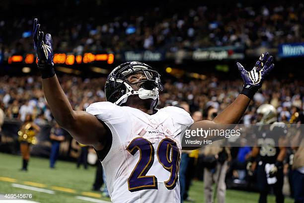 Justin Forsett of the Baltimore Ravens celebrates a touchdown against the New Orleans Saints during the fourth quarter of a game at the MercedesBenz...