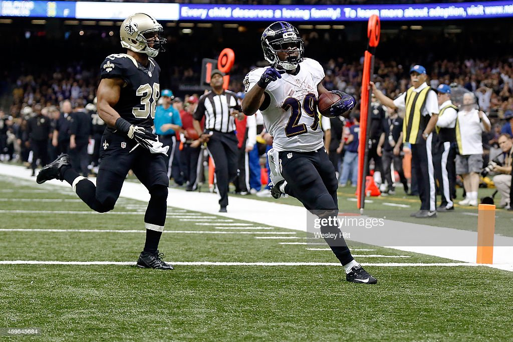 Justin Forsett #29 of the Baltimore Ravens rushes for a touchdown during the fourth quarter of a game against the New Orleans Saints at the Mercedes-Benz Superdome on November 24, 2014 in New Orleans, Louisiana.