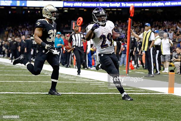 Justin Forsett of the Baltimore Ravens rushes for a touchdown during the fourth quarter of a game against the New Orleans Saints at the MercedesBenz...