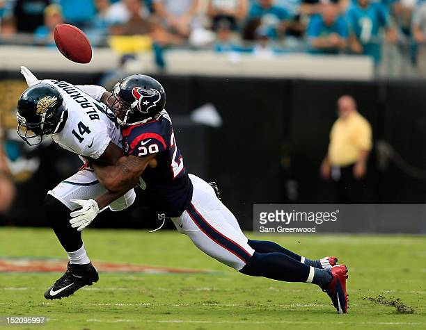 Justin Forsett of the Houston Texans breaks up a pass attempt to Justin Blackmon of the Jacksonville Jaguars during the game at EverBank Field on...