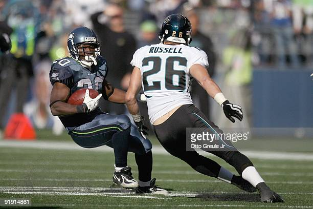 Justin Forsett of the Seattle Seahawks carries the ball against Brian Russell of the Jacksonville Jaguars on October 11 2009 at Qwest Field in...