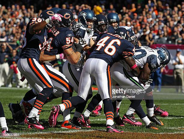 Justin Forsett of the Seattle Seahawks scores a touchdown pursues by Chris Harris Brian Urlacher and Danieal Manning of the Chicago Bears at Soldier...