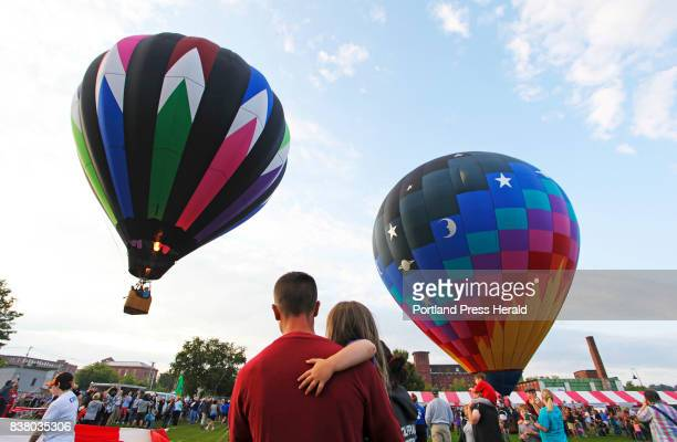 Justin Fortier of Lewiston and his daughter Jocelyn watch liftoff at Simard Payne Park at the Great Falls Balloon Festival