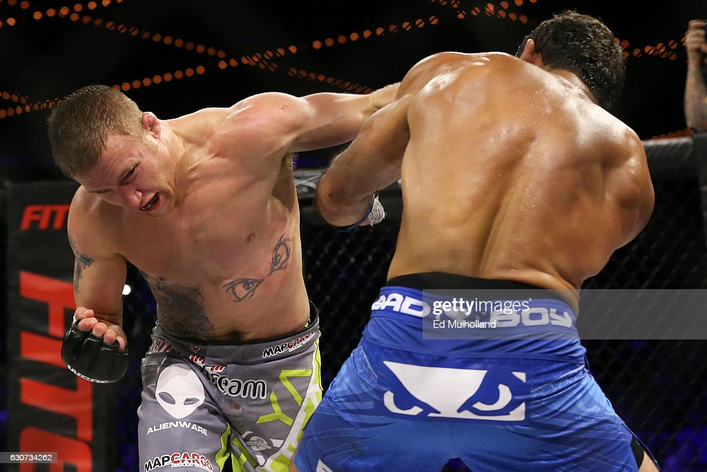 Justin Gaethje (green/gray trunks) and challenger Luis Firmino (blue trunks) trade punches during their World Series of Fighting lightweight championship fight at The Theater at Madison Square Garden on December 31, 2016 in New York City.