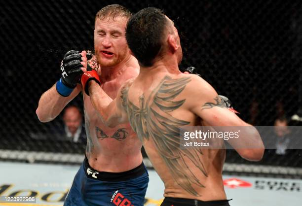Justin Gaethje and Tony Ferguson trade punches in their UFC interim lightweight championship fight during the UFC 249 event at VyStar Veterans...