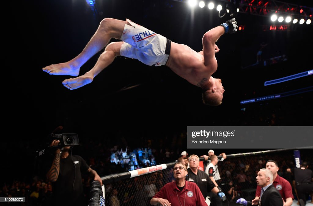 Justin Gaethje celebrates by doing a backflip off the Octagon after defeating Michael Johnson in their lightweight bout during The Ultimate Fighter Finale at T-Mobile Arena on July 7, 2017 in Las Vegas, Nevada.