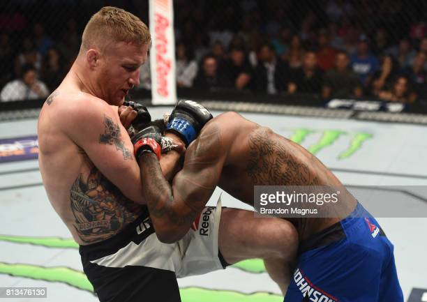 Justin Gaethje knees Michael Johnson after their lightweight bout during The Ultimate Fighter Finale at TMobile Arena on July 7 2017 in Las Vegas...