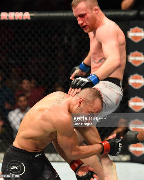 Justin Gaethje lands a flying knee against Eddie Alvarez in their lightweight bout during the UFC 218 event inside Little Caesars Arena on December...