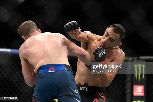Justin Gaethje of the United States and Tony Ferguson of the United States fight in their Interim lightweight title fight during UFC 249 at VyStar...