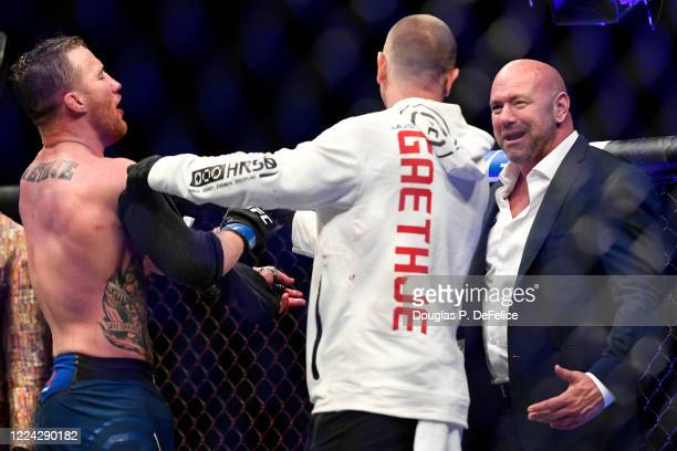 Justin Gaethje of the United States and UFC President Dana White talk after defeating Tony Ferguson of the United States in their Interim lightweight...