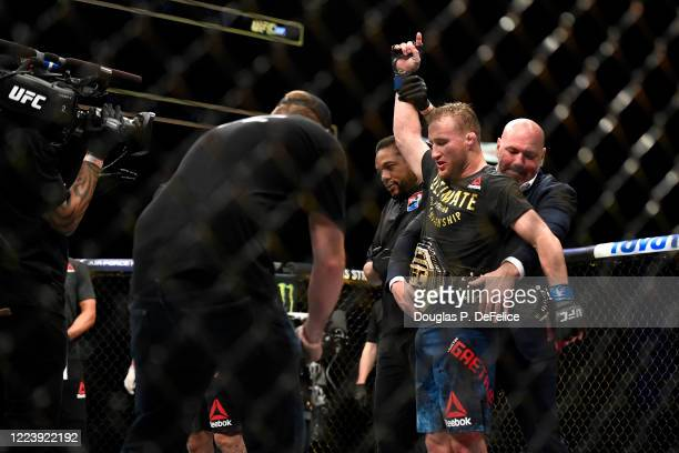 Justin Gaethje of the United States celebrates after defeating Tony Ferguson of the United States in their Interim lightweight title fight during UFC...