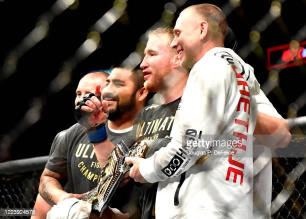 Justin Gaethje of the United States celebrates with his team after defeating Tony Ferguson of the United States in their Interim lightweight title...