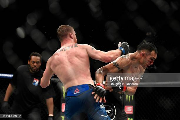 Justin Gaethje of the United States fights Tony Ferguson of the United States in their Interim lightweight title fight during UFC 249 at VyStar...
