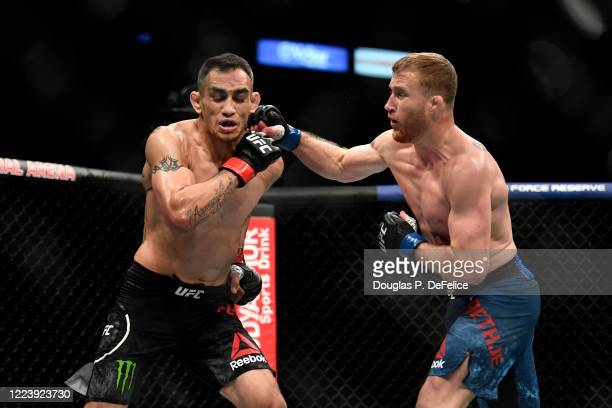 Justin Gaethje of the United States punches Tony Ferguson of the United States in their Interim lightweight title fight during UFC 249 at VyStar...
