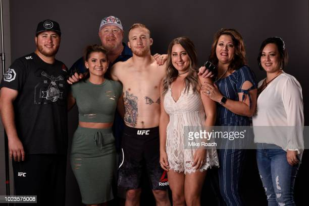 Justin Gaethje poses for a photo with his family backstage after his victory over James Vick during the UFC Fight Night event at Pinnacle Bank Arena...