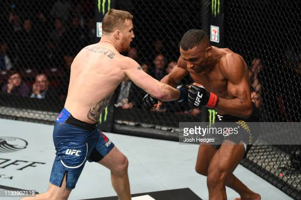 Justin Gaethje punches Edson Barboza of Brazil in their lightweight bout during the UFC Fight Night event at Wells Fargo Center on March 30 2019 in...