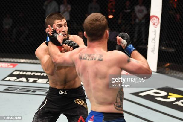 Justin Gaethje punches Khabib Nurmagomedov of Russia in their lightweight title bout during the UFC 254 event on October 25, 2020 on UFC Fight...