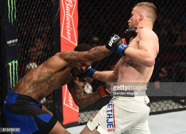 Justin Gaethje punches Michael Johnson after their lightweight bout during The Ultimate Fighter Finale at TMobile Arena on July 7 2017 in Las Vegas...