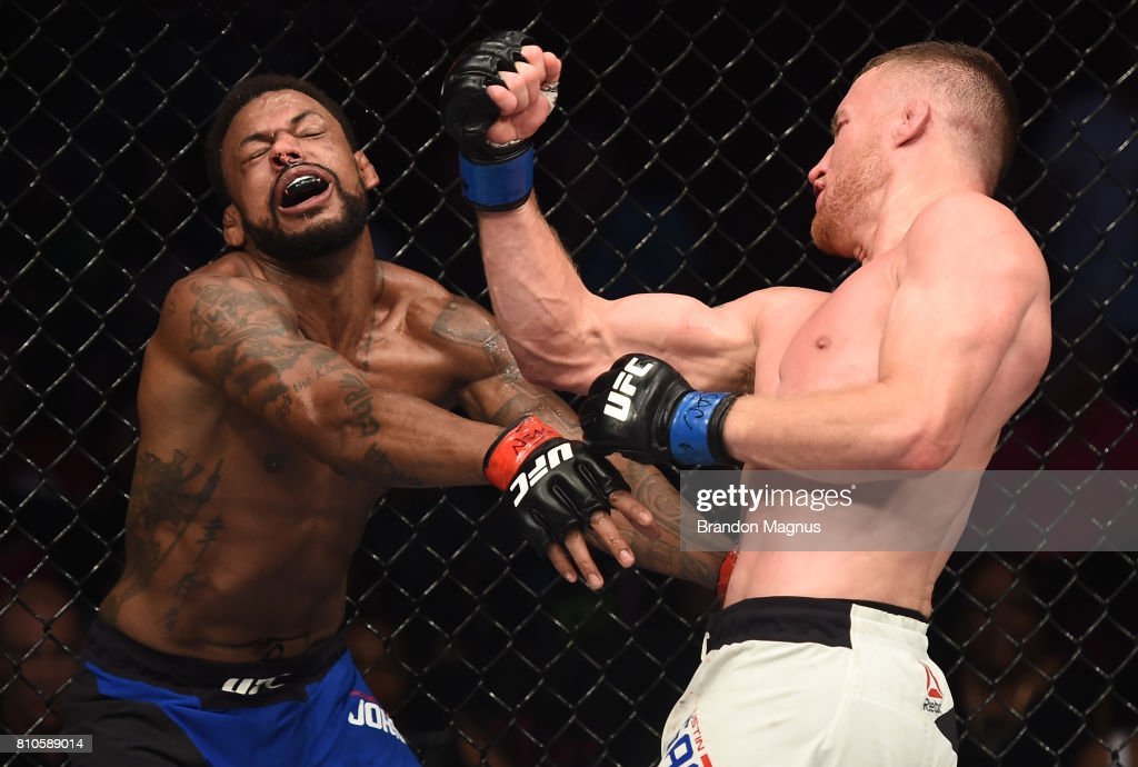 Justin Gaethje punches Michael Johnson in their lightweight bout during The Ultimate Fighter Finale at T-Mobile Arena on July 7, 2017 in Las Vegas, Nevada.