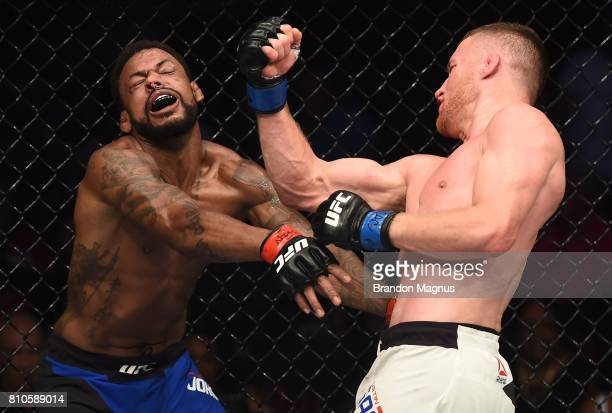 Justin Gaethje punches Michael Johnson in their lightweight bout during The Ultimate Fighter Finale at TMobile Arena on July 7 2017 in Las Vegas...