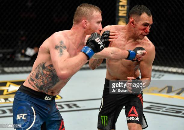 Justin Gaethje punches Tony Ferguson in their UFC interim lightweight championship fight during the UFC 249 event at VyStar Veterans Memorial Arena...