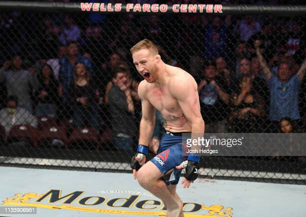 Justin Gaethje reacts after knocking out Edson Barboza of Brazil in their lightweight bout during the UFC Fight Night event at Wells Fargo Center on...