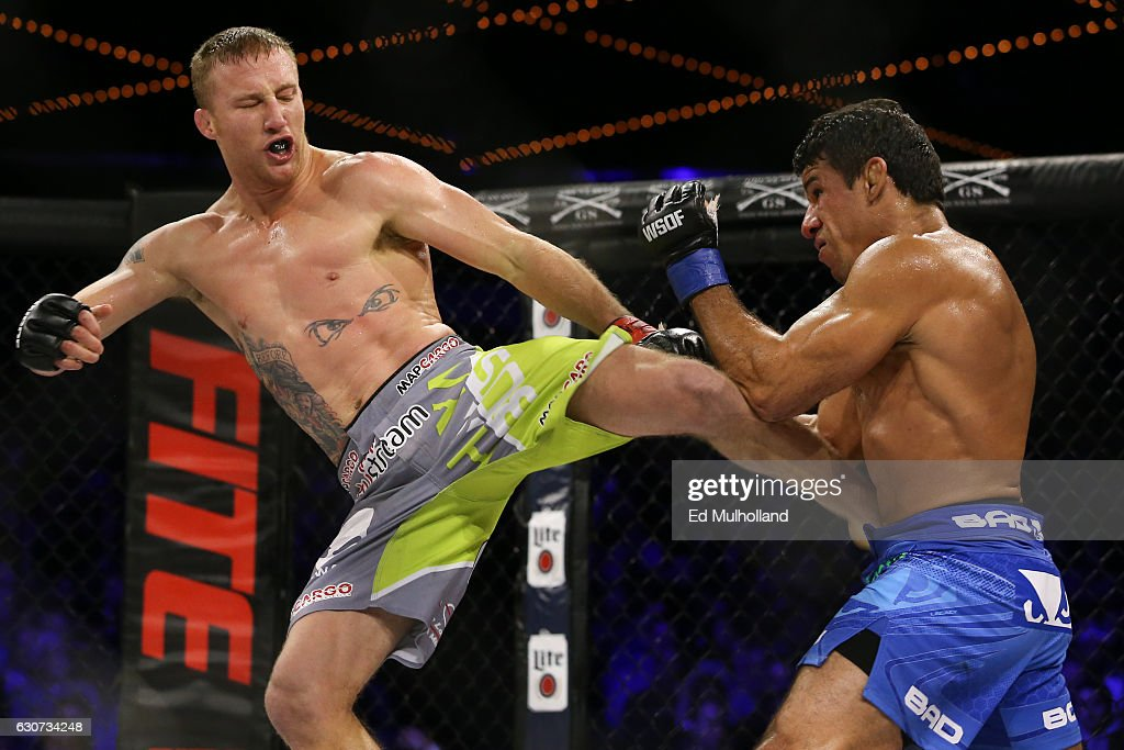 Justin Gaethje (left) throws a kick to the body of challenger Luis Firmino () during their World Series of Fighting lightweight championship fight at The Theater at Madison Square Garden on December 31, 2016 in New York City.
