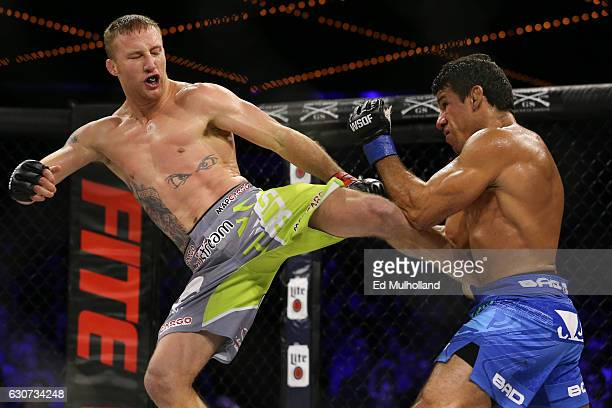 Justin Gaethje throws a kick to the body of challenger Luis Firmino during their World Series of Fighting lightweight championship fight at The...