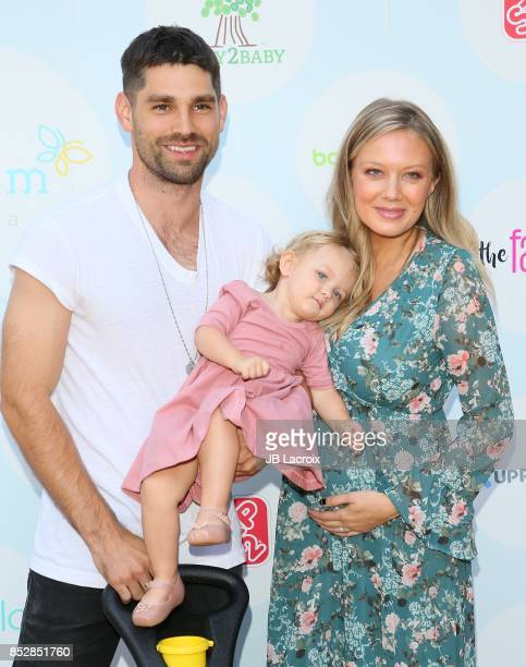 Justin Gaston actress Melissa Ordway and Olivia Gaston attend the 6th Annual Celebrity Red CARpet Safety Awareness Event on September 23 2017 in...