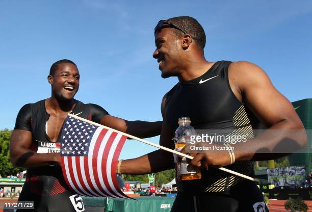 Justin Gatlin and Walter Dix celebrate together after Gatlin finished in second place and Dix in first place in the Men's 100 meter dash final on day...