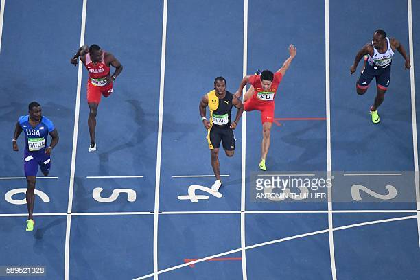 US Justin Gatlin Bahrain's Kemarley Brown Jamaica's Yohan Blake China's Su Bingtian and Britain's James Dasaolu compete in the Men's 100m Semifinal...