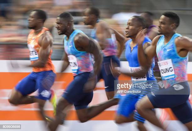 Justin Gatlin competes to win the men's 100m event during the Diamond League athletics meeting Athletissima in Lausanne on July 6 2017 / AFP PHOTO /...