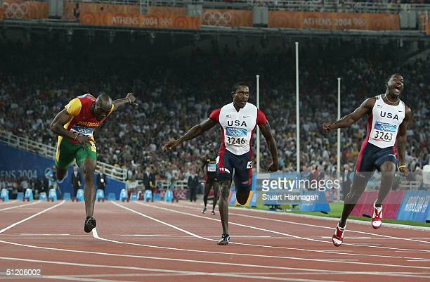 Justin Gatlin crosses the finish line as he win's the men's 100 metre final on August 22, 2004 during the Athens 2004 Summer Olympic Games at the...