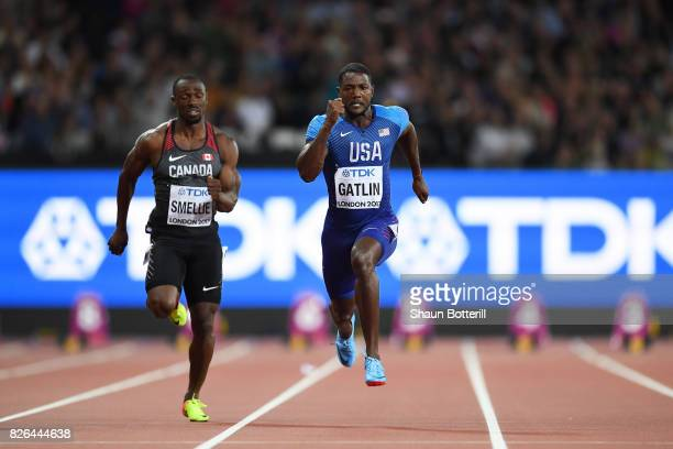 Justin Gatlin of the United States and Gavin Smellie of Canada competes in the Men's 100 metres heats during day one of the 16th IAAF World Athletics...