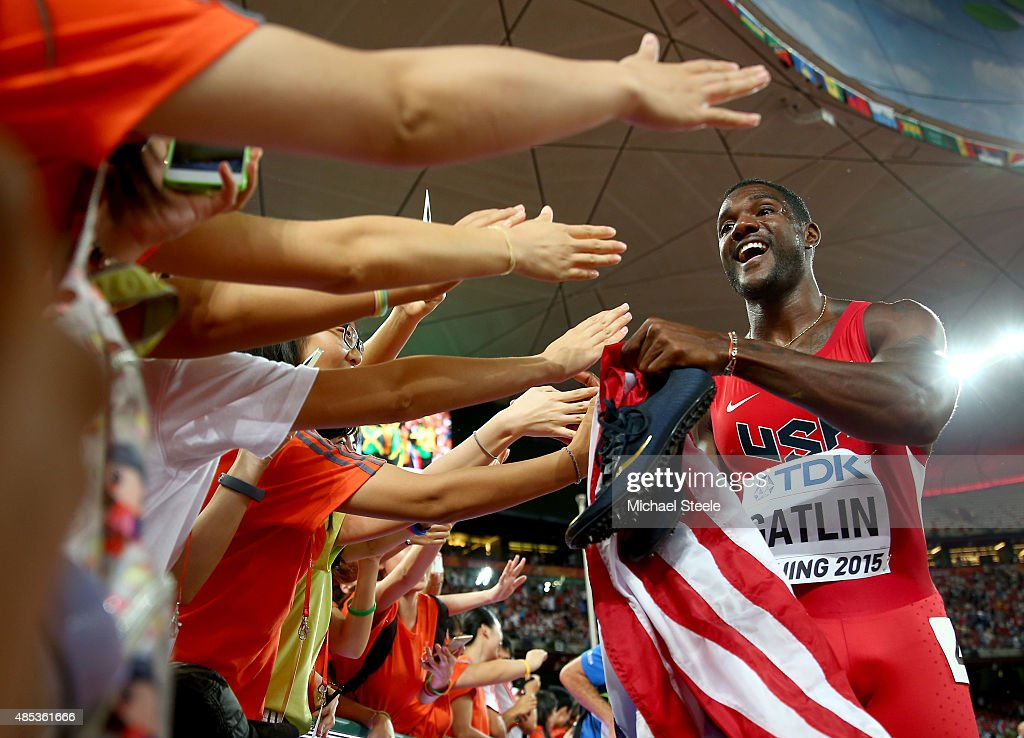 Justin Gatlin of the United States celebrates with supporters after crossing the finish line to win silver in the Men's 200 metres final during day six of the 15th IAAF World Athletics Championships Beijing 2015 at Beijing National Stadium on August 27, 2015 in Beijing, China.