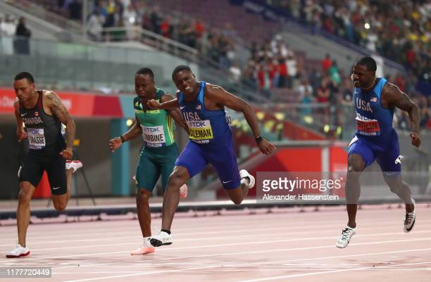 Justin Gatlin of the United States Christian Coleman of the United States Akani Simbine of South Africa and Andre De Grasse of Canada cross the...