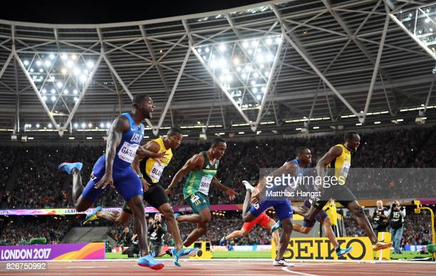 Justin Gatlin of the United States crosses the finish line and celebrates his win in the Men's 100 metres final in 992 seconds as Christian Coleman...