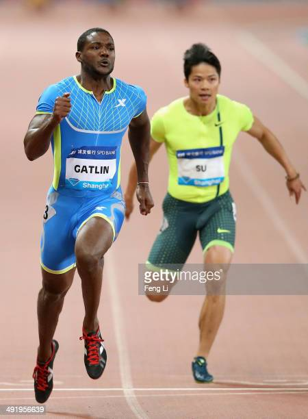 Justin Gatlin of the United States crosses the finishing line as Su Bingtian of China followed during the Men's 100m of the Diamond League Track and...