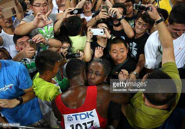 Justin Gatlin of the United States embraces his mother Jeanette Gatlin after winning silver in the Men's 100 metres final during day two of the 15th...