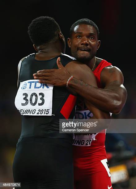 Justin Gatlin of the United States is congratulated by Aaron Brown of Canada after crossing the finish line in the Men's 100 metres semifinal during...