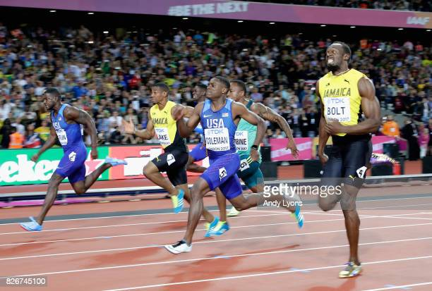Justin Gatlin of the United States leads the Men's 100 metres final from Christian Coleman of the United States and Usain Bolt of Jamaica during day...